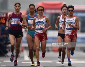 (L/R): Kyrgyzstan's Iuliia Andreeva, Kazakhstan's Gulzhanat Zhanatbek, Japan's Ryoko Kizaki, South Korea's Choi Bora and Japan's Eri Hayakawa run as they compete in the final of the women's marathon athletics event during the 17th Asian Games on the Marathon Course in Incheon on October 2, 2014.   AFP PHOTO / MANAN VATSYAYANA        (Photo credit should read MANAN VATSYAYANA/AFP via Getty Images)