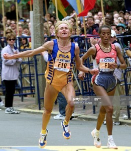 "BOSTON, :  Irina Bogacheva of Kyrgyzstan (L) crosses the finish line to finish second in front of third place finisher Fatuma Roba of Ethiopia in the woman's division of 104th running of the Boston Marathon in Boston 17 April, 2000. Catherine Ndereba won with a time of 2:26'10"". (ELECTRONIC IMAGE) AFP PHOTO/Timothy A. Clary (Photo credit should read TIMOTHY A. CLARY/AFP via Getty Images)"