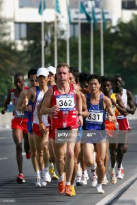 DOHA, QATAR - DECEMBER 10:  Valery Pisarev of Kyrgyzstan leads a group of athletes in the Men's Marathon Final during the 15th Asian Games Doha 2006 at Qatar at the Marathon Street Circuit on December 10, 2006 in Doha, Qatar.  (Photo by Harry How/Getty Images)